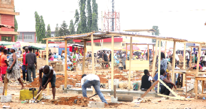 Some traders constructing structures for their wares at the Redco Market